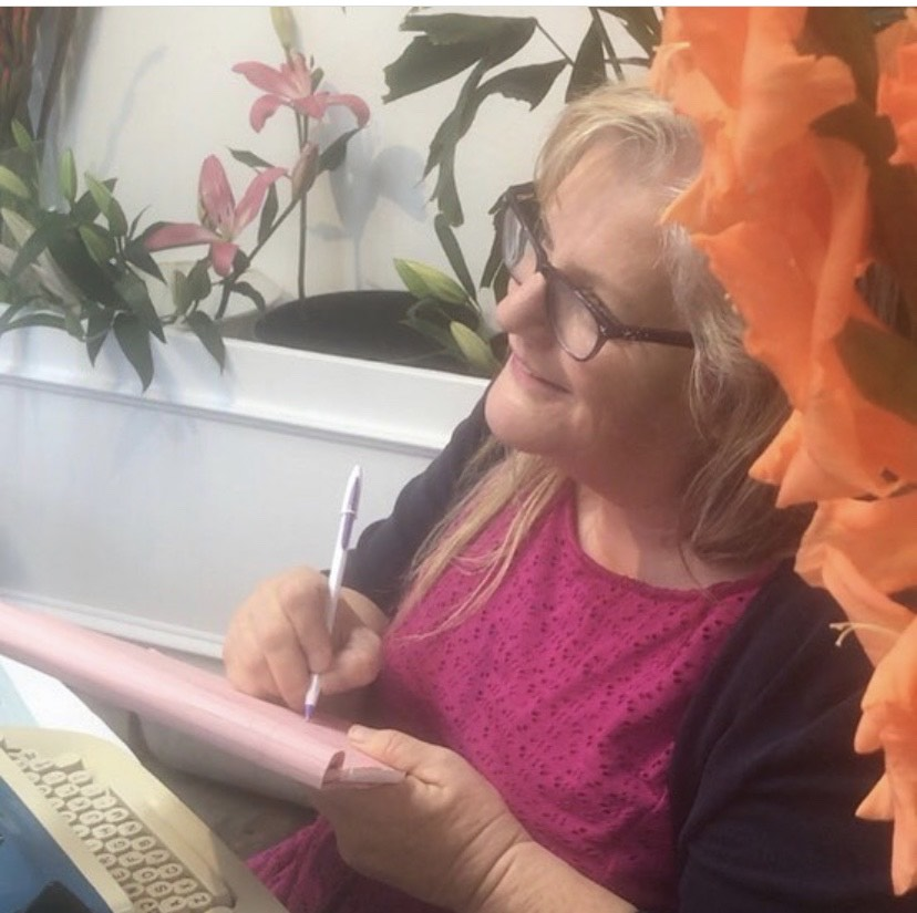 Julie JordanScott writing poetry at a downtown Bakersfield flower shop.