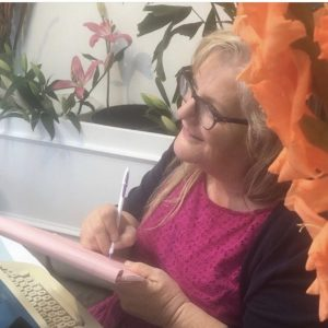 Julie JordanScott writing personalized love poetry.