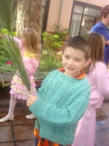 Seven-Year-Old Samuel preparing for Palm Sunday Service in 2008. Little Children at this church provide hope for the participants in the beginning of the Christian Celebration of Holy Week.
