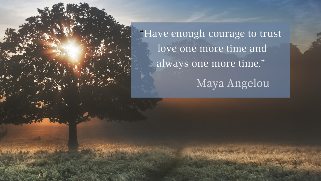 "Light through a  tree at sunrise with the Maya Angelou quote, ""Have enough courage to trust love one more time and always one more time."""