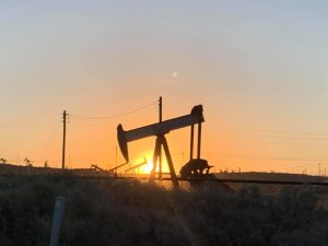 A pumpjack (oil well) in North Bakersfield at sunrise.