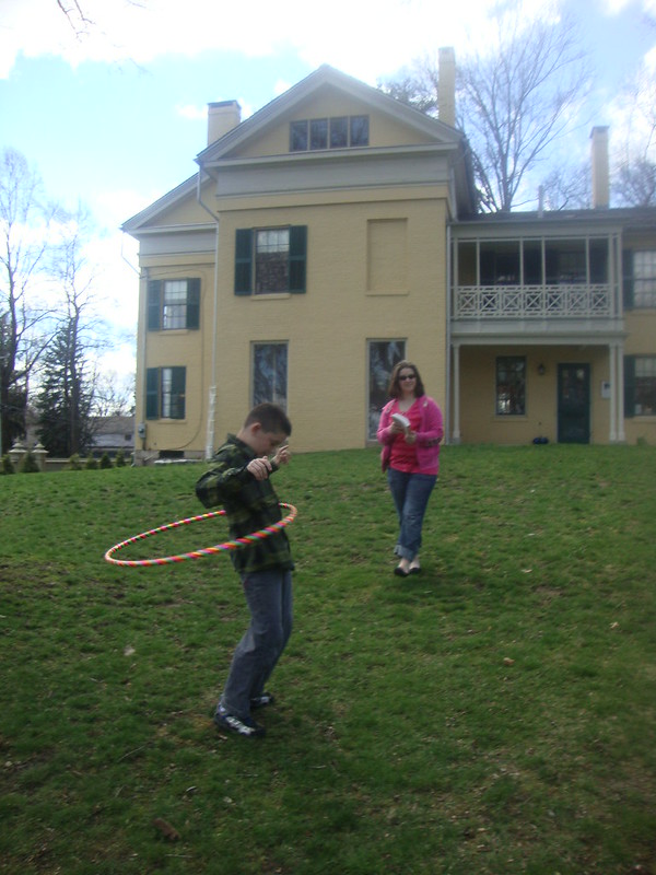 My son, Samuel, is hula hooping on Emily Dickinson's lawn.
